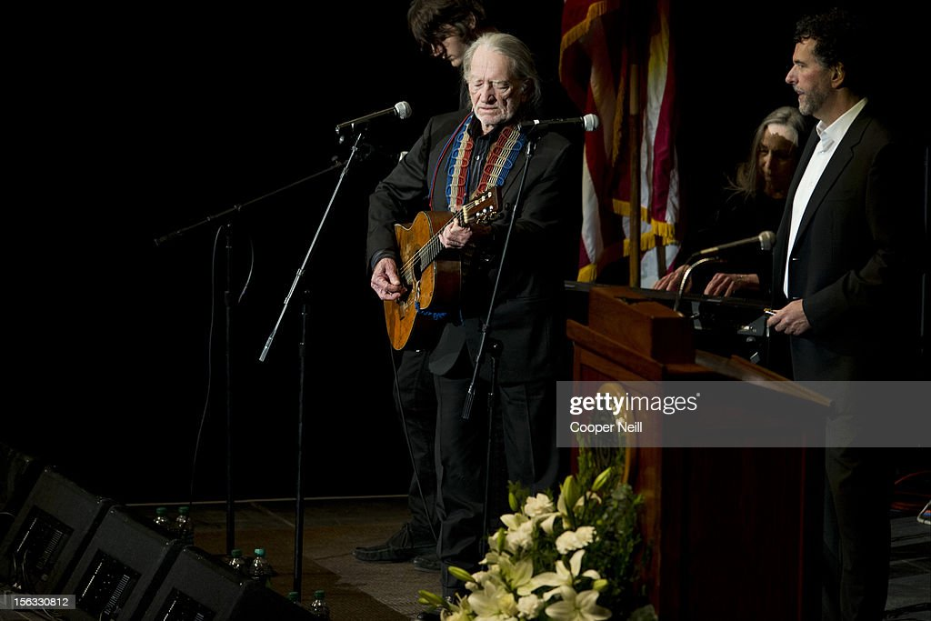 <a gi-track='captionPersonalityLinkClicked' href=/galleries/search?phrase=Willie+Nelson&family=editorial&specificpeople=203154 ng-click='$event.stopPropagation()'>Willie Nelson</a> performs during a memorial service for former University of Texas Longhorns head coach Darrell K Royal on November 13, 2012 at the Frank Erwin Center in Austin, Texas.