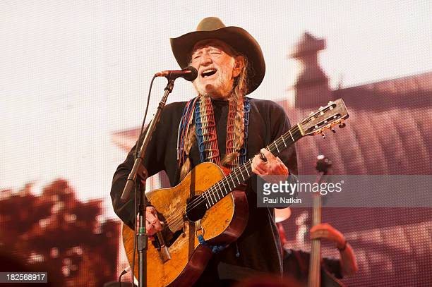 Willie Nelson performs during Farm Aid 2013 at Saratoga Performing Arts Center on September 21 2013 in Saratoga Springs New York