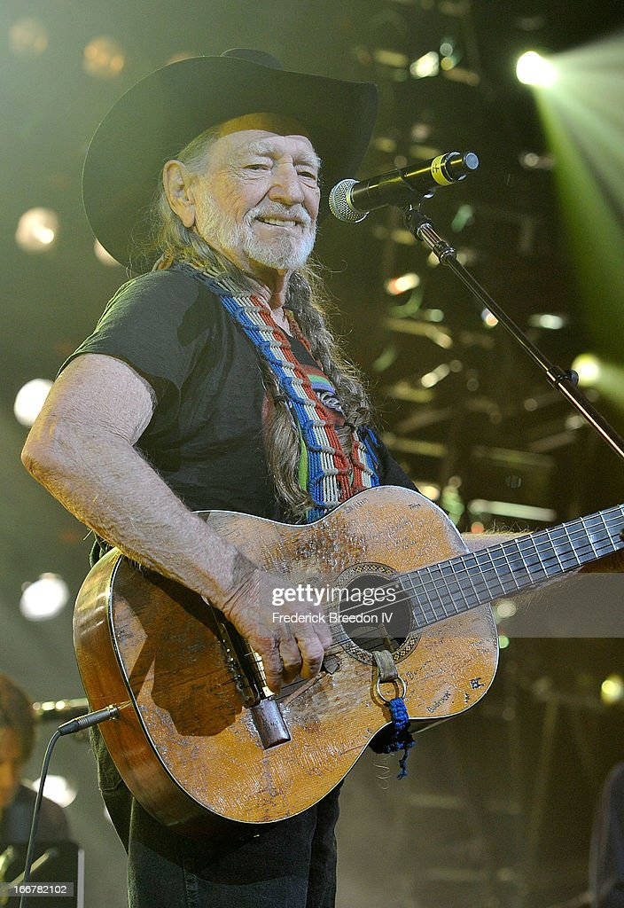 <a gi-track='captionPersonalityLinkClicked' href=/galleries/search?phrase=Willie+Nelson&family=editorial&specificpeople=203154 ng-click='$event.stopPropagation()'>Willie Nelson</a> performs during Keith Urban's Fourth annual We're All For The Hall benefit concert at Bridgestone Arena on April 16, 2013 in Nashville, Tennessee.
