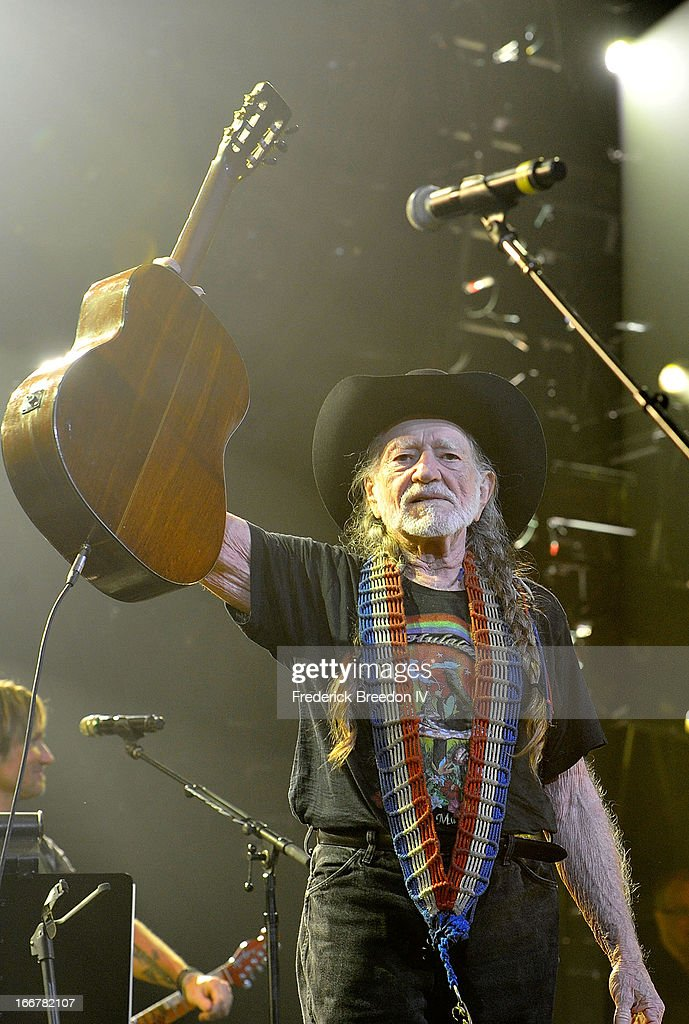 Willie Nelson performs during Keith Urban's Fourth annual We're All For The Hall benefit concert at Bridgestone Arena on April 16, 2013 in Nashville, Tennessee.