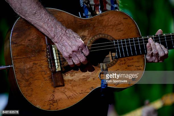 Willie Nelson plays the guitar during a concert at Farm Aid 2017 on September 16 2017 at Keybank Pavilion in Hanover Township PA