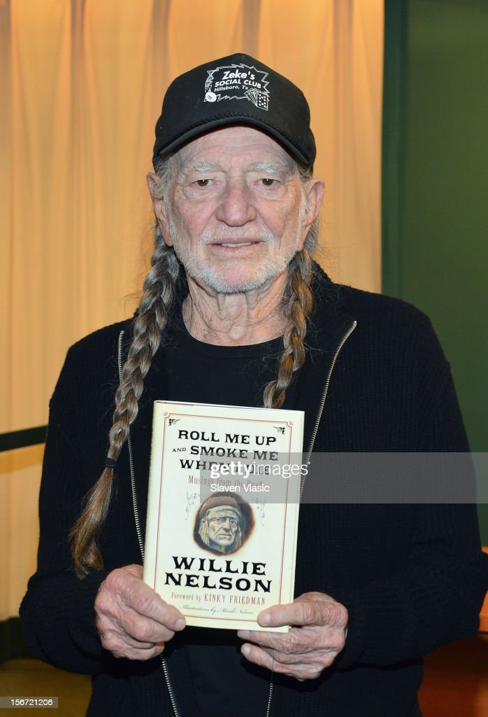 "Willie Nelson Signs Copies Of His Book ""Roll Me Up And Smoke Me When I Die: Musings From The Road"""