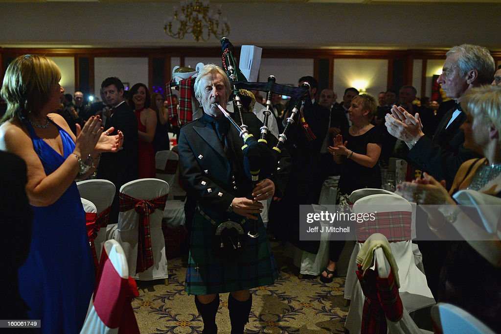 Willie Park plays plays bagpipes as the haggis is brought in at the Lord Provost Burns Supper, in the Thistle Hotel on on January 25, 2012 in Glasgow, Scotland. Burns suppers will be held today to commemorate the life of the poet Robert Burns, who was born on this day in 1759.