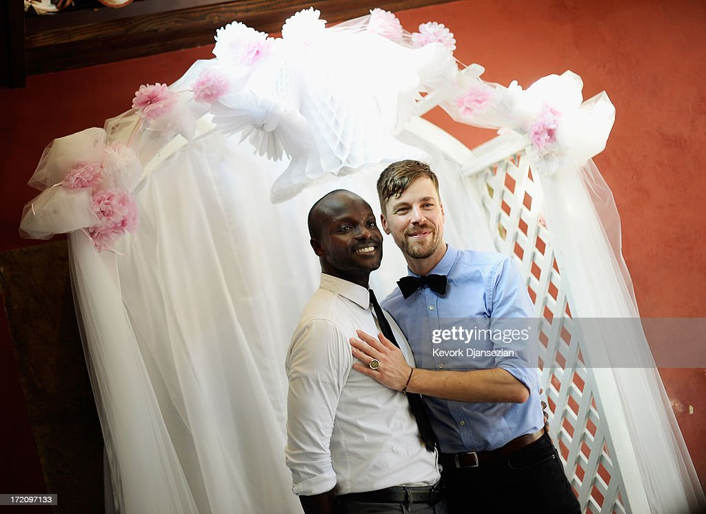 Willie Phearson, 35, (L) and Gregory Locklear, 36, pose at a wedding celebration at The Abbey after their wedding ceremony on July 1, 2013 in West Hollywood, California. The U.S. Ninth Circuit Court of Appeals lifted California's ban on same-sex marriages just three days after the Supreme Court ruled that supporters of the ban, Proposition 8, could not defend it before the high court. California Gov. Jerry Brown ordered all counties in the state to begin issuing licenses immediately.