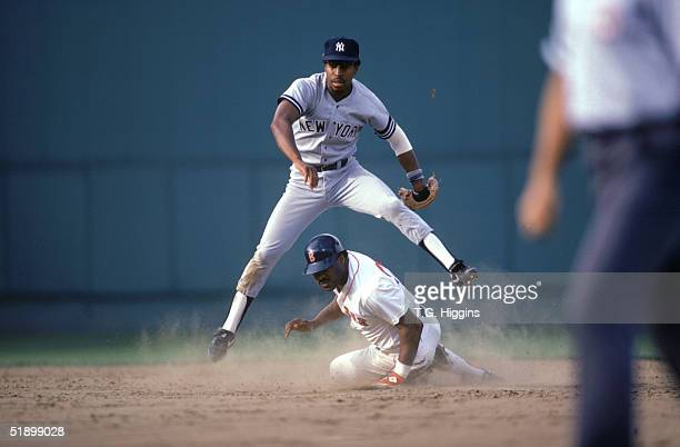 Willie Randolph of the New York Yankees tags a player out on second base during the game against the Boston Red Sox at Fenway Park in 1989 in Boston...