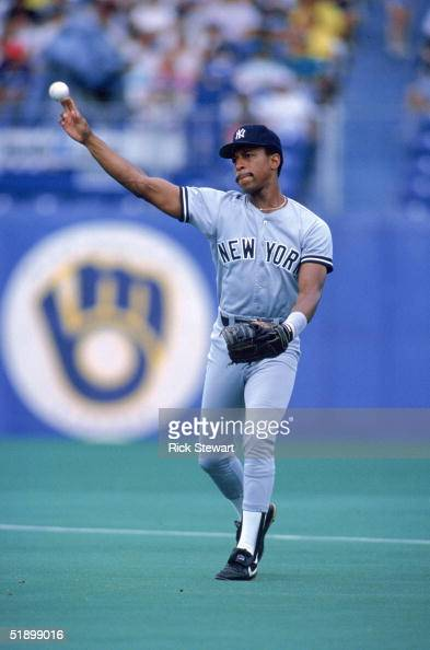 Willie Randolph of the New York Yankees throws the ball back to the infield during the game against the Toronto Blue Jays in 1988 at Exhibition...
