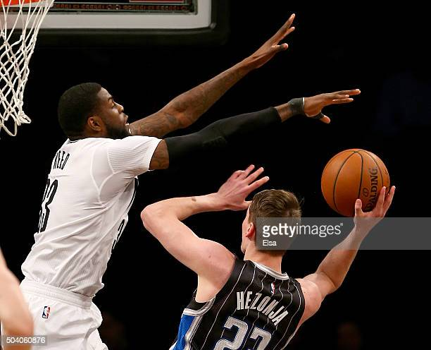 Willie Reed of the Brooklyn Nets blocks a shot by Mario Hezonja of the Orlando Magic in the first half on January 82016 at the Barclays Center in the...