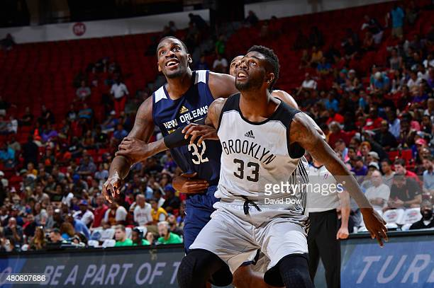 Willie Reed of the Brooklyn Nets boxes out against Jarvis Vornado of the New Orleans Pelicans during the 2015 NBA Las Vegas Summer League game on...