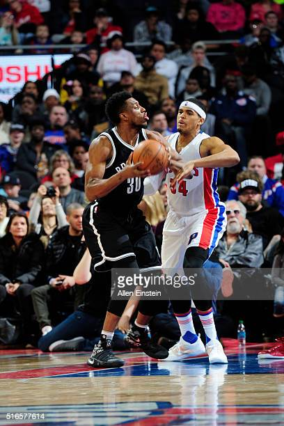 Willie Reed of the Brooklyn Nets defends the ball against the Detroit Pistons during the game on March 19 2016 at The Palace of Auburn Hills in...