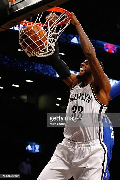 Willie Reed of the Brooklyn Nets dunks the ball against the Philadelphia 76ers at Barclays Center on December 10 2015 in Brooklyn borough of New York...