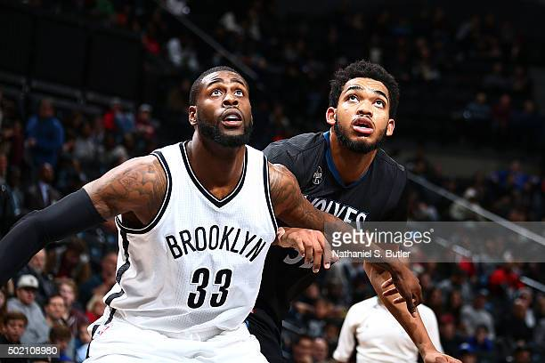 Willie Reed of the Brooklyn Nets fights for the position against KarlAnthony Towns of the Minnesota Timberwolves during the game on December 20 2015...