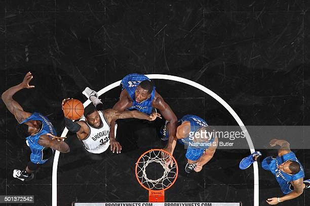 Willie Reed of the Brooklyn Nets goes up for a dunk against the Orlando Magic on December 14 2015 at Barclays Center in Brooklyn New York NOTE TO...