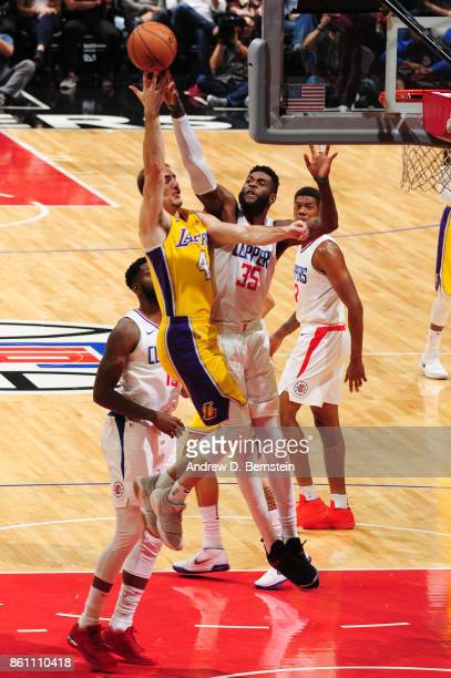 Willie Reed of the LA Clippers goes for a block against Alex Caruso of the Los Angeles Lakers on October 13 2017 at STAPLES Center in Los Angeles...