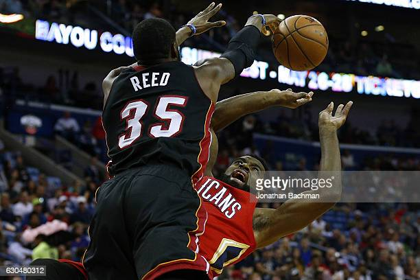 Willie Reed of the Miami Heat blocks a shot from Tyreke Evans of the New Orleans Pelicans during the first half of a game at the Smoothie King Center...