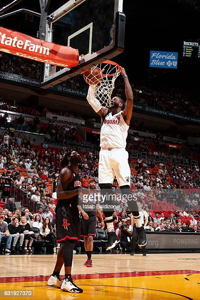 Willie Reed of the Miami Heat dunks the ball during the game against the Houston Rockets on January 17 2017 at AmericanAirlines Arena in Miami...