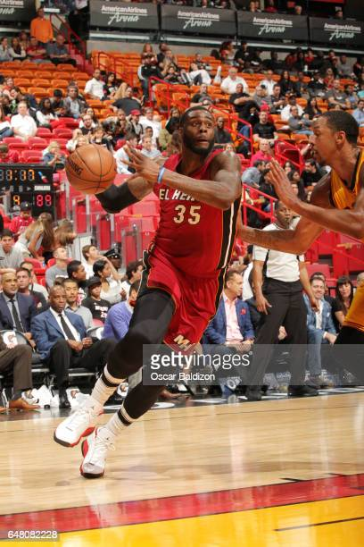 Willie Reed of the Miami Heat handles the ball against the Cleveland Cavaliers during the game on March 4 2017 at American Airlines Arena in Miami...
