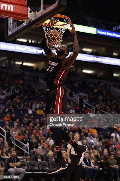 Willie Reed of the Miami Heat slam dunks the ball against the Phoenix Suns during the first half of the NBA game at Talking Stick Resort Arena on...