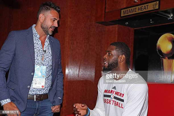 Willie Reed of the Miami Heat talks to Leonardo Montero an Argentine TV host before the game against the Oklahoma City Thunder on December 27 2016 at...