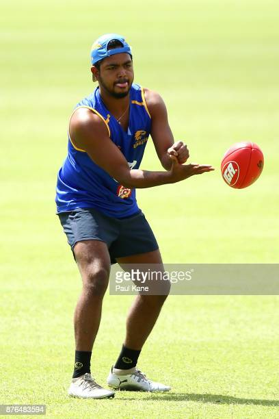 Willie Rioli of the Eagles handballs during a West Coast Eagles AFL training session at Lathlain Park on November 20 2017 in Perth Australia
