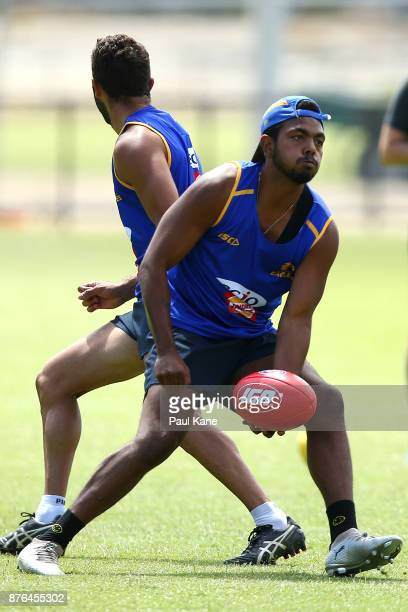 Willie Rioli of the Eagles looks to handball during a West Coast Eagles AFL training session at Lathlain Park on November 20 2017 in Perth Australia