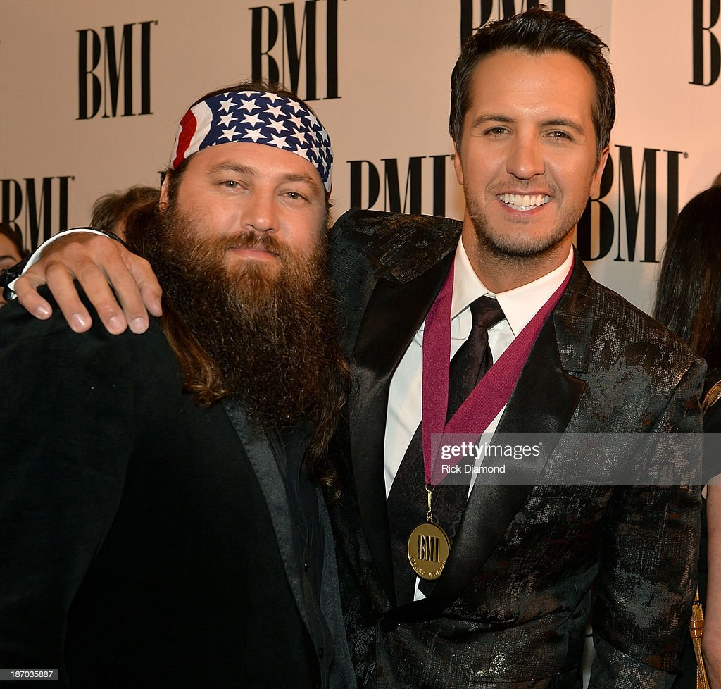 Willie Robertson of Duck Dynasty and country singer Luke Bryan attend the 61st annual BMI Country awards on November 5, 2013 in Nashville, Tennessee.