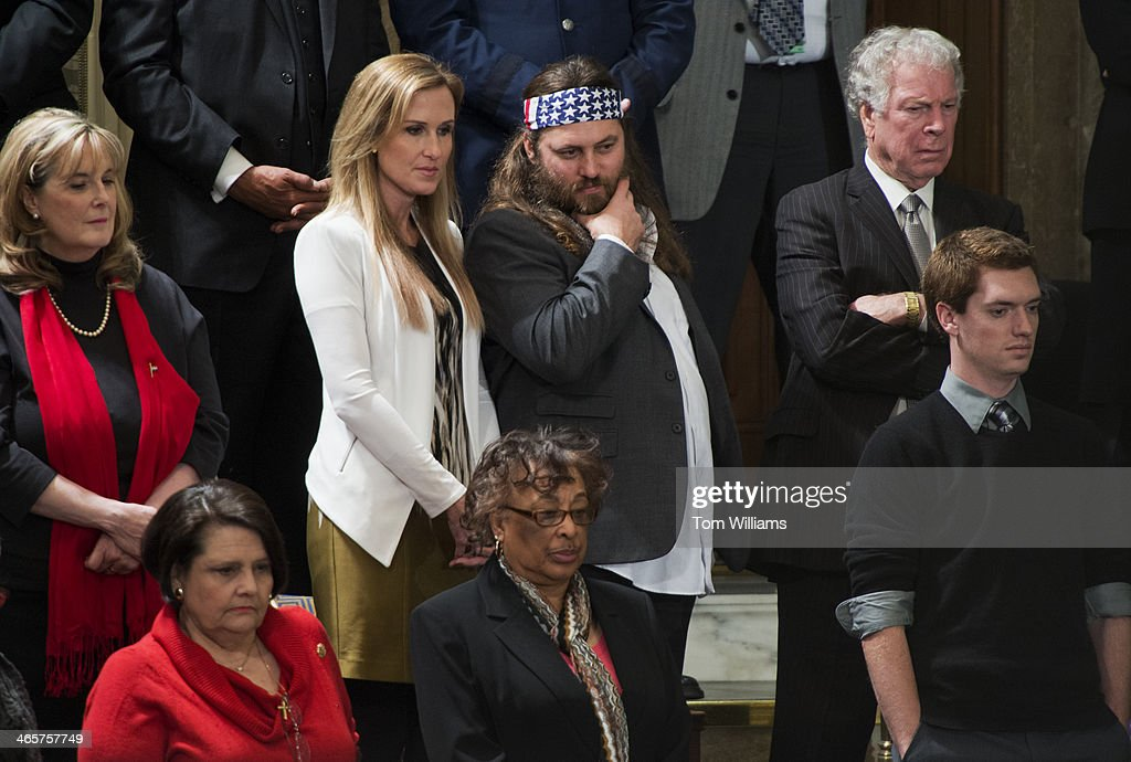 Willie Robertson of Duck Dynasty, and his wife Korie, appear in the gallery before President Obama's State of the Union address in the Capitol. Willie Robertson was the guest of Rep. Vance McAllister, R-La.