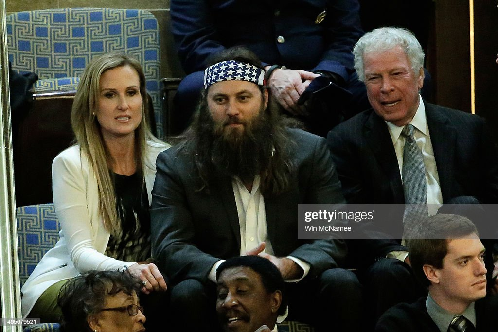 Willie Robertson (C) of the television show Duck Dynasty and his wife Korie Robertson wait for U.S. President Barack Obama to deliver the State of the Union address to a joint session of Congress in the House Chamber at the U.S. Capitol on January 28, 2014 in Washington, DC. In his fifth State of the Union address, Obama is expected to emphasize on healthcare, economic fairness and new initiatives designed to stimulate the U.S. economy with bipartisan cooperation.