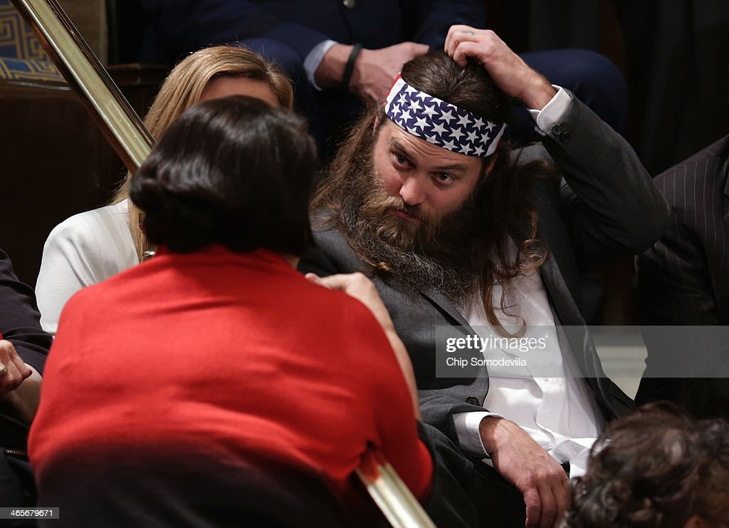 Willie Robertson (R) of the television show Duck Dynasty and his wife Korie Robertson (obscured) wait for U.S. President Barack Obama to deliver the State of the Union address to a joint session of Congress in the House Chamber at the U.S. Capitol on January 28, 2014 in Washington, DC. In his fifth State of the Union address, Obama is expected to emphasize on healthcare, economic fairness and new initiatives designed to stimulate the U.S. economy with bipartisan cooperation.