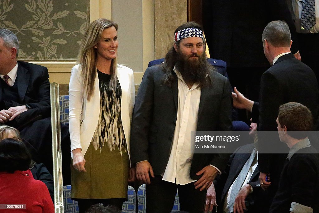 Willie Robertson (R) of the television show Duck Dynasty and his wife Korie Robertson wait for U.S. President Barack Obama to deliver the State of the Union address to a joint session of Congress in the House Chamber at the U.S. Capitol on January 28, 2014 in Washington, DC. In his fifth State of the Union address, Obama is expected to emphasize on healthcare, economic fairness and new initiatives designed to stimulate the U.S. economy with bipartisan cooperation.