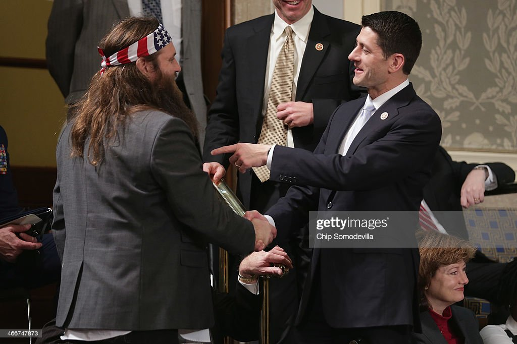 Willie Robertson (L) of the television show Duck Dynasty talks with Rep. Paul Ryan (R-WI) before U.S. President Barack Obama delivers the State of the Union address to a joint session of Congress in the House Chamber at the U.S. Capitol on January 28, 2014 in Washington, DC. In his fifth State of the Union address, Obama is expected to emphasize on healthcare, economic fairness and new initiatives designed to stimulate the U.S. economy with bipartisan cooperation.