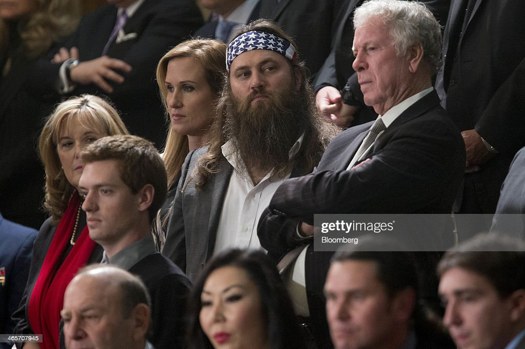 Willie Robertson, television personality from A&E Television Networks LLC's Duck Dynasty show, center, waits to listen to U.S. President Barack Obama, not pictured, deliver the State of the Union address to a joint session of Congress at the Capitol in Washington, D.C., U.S., on Tuesday, Jan. 28, 2014. Obama offered modest steps to chip away at the country's economic and social challenges in a State of the Union address that reflects the limits of his power to sway Congress. Photographer: Andrew Harrer/Bloomberg via Getty Images
