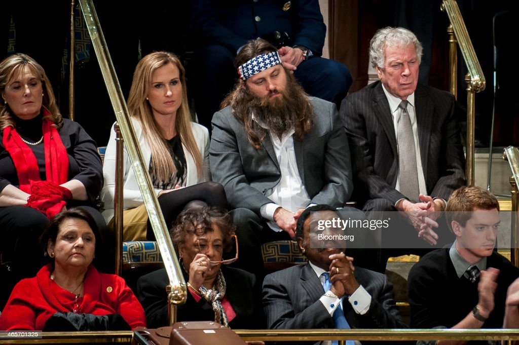 Willie Robertson, top row second right, cast member of reality TV show 'Duck Dynasty', looks on as U.S. President Barack Obama, unseen, delivers the State of the Union address to a joint session of Congress at the Capitol in Washington, D.C., U.S., on Tuesday, Jan. 28, 2014. President Barack Obama urged Congress to back two priorities for U.S. multinational corporations: broader authority for his administration to negotiate trade deals, and changes to immigration laws. Photographer: Pete Marovich/Bloomberg via Getty Images