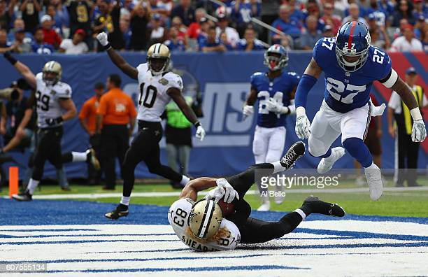 Willie Snead IV of the New Orleans Saints scores a touchdown against Darian Thompson of the New York Giants during the fourth quarter at MetLife...