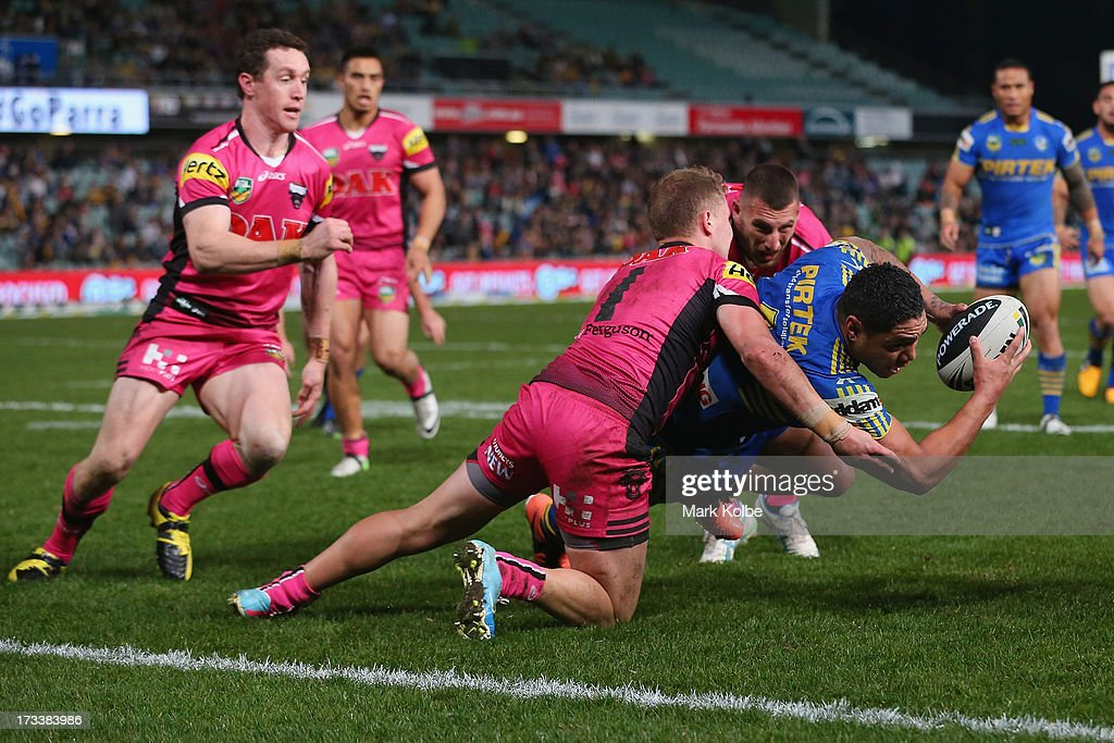 <a gi-track='captionPersonalityLinkClicked' href=/galleries/search?phrase=Willie+Tonga&family=editorial&specificpeople=207059 ng-click='$event.stopPropagation()'>Willie Tonga</a> of the Eels is tackled short of the line during the round 18 NRL match between Parramatta Eels and the Penrith Panthers at Parramatta Stadium on July 13, 2013 in Sydney, Australia.