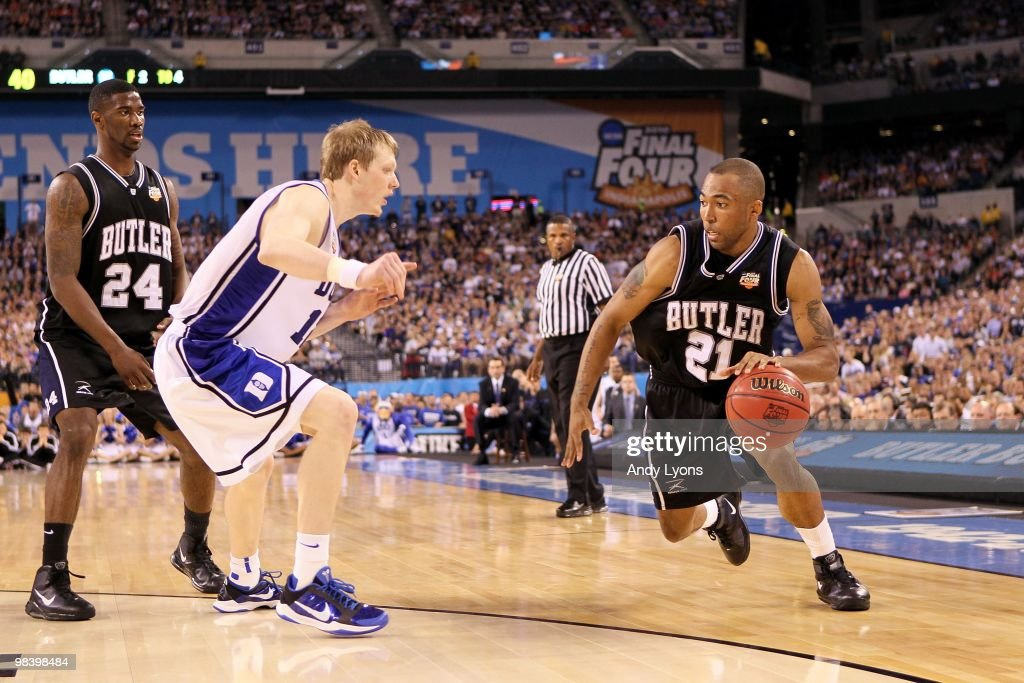 Willie Veasley of the Butler Bulldogs drives against Kyle Singler of the Duke Blue Devils during the 2010 NCAA Division I Men's Basketball National...