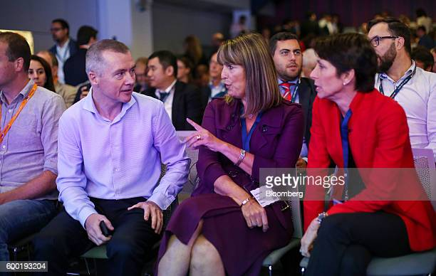 Willie Walsh chief executive officer of International Consolidated Airlines Group SA left speaks Jayne Hrdlicka chief executive officer of Jetstar...