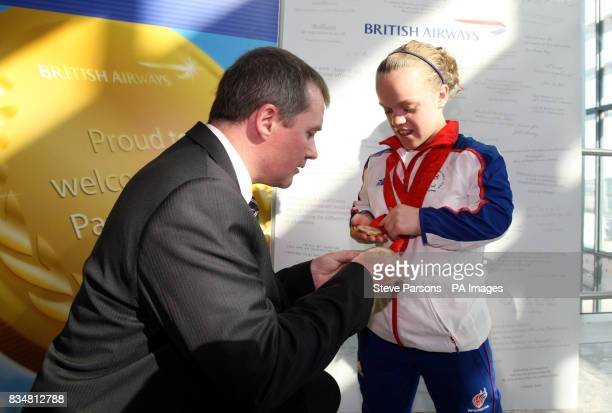 Willie Walsh meets 13 year old Eleanor Simmonds at Heathrow Airport as she gets off the plane from Beijing at Heathrow Airport London