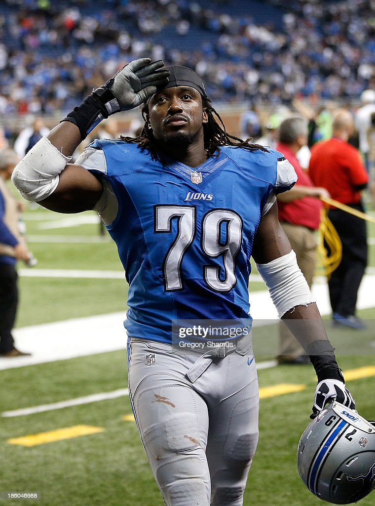 Willie Young #79 of the Detroit Lions acknowledges fans while leaving the field after a 31-30 win over the Dallas Cowboys at Ford Field on October 27, 2013 in Detroit, Michigan.