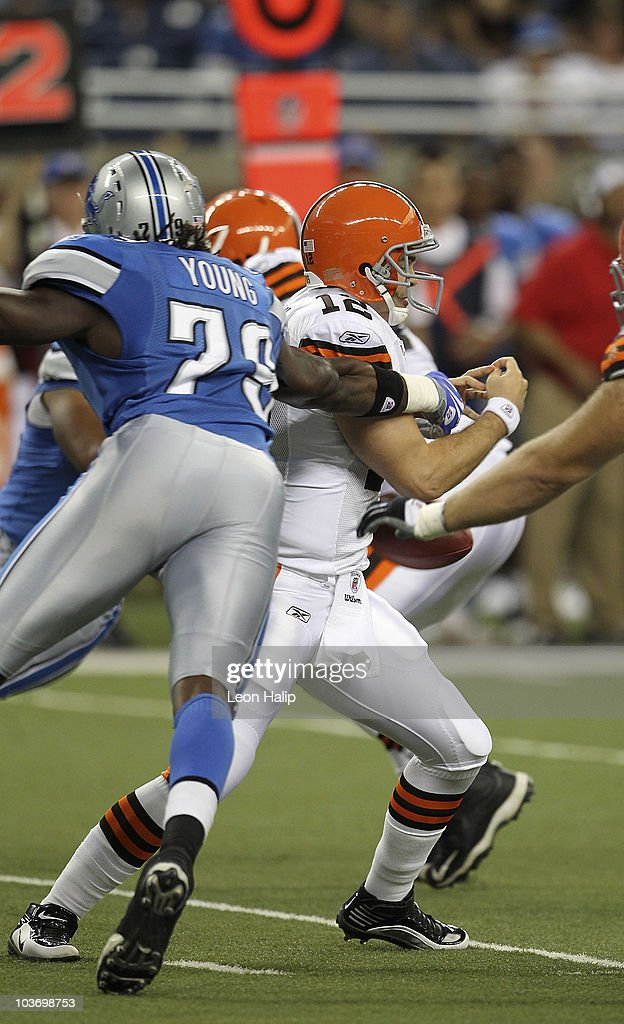 Willie Young #79 of the Detroit Lions slaps the ball away from Colt McCoy #12 of the Cleveland Browns during the fourth quarter of the preseason game at Ford Field on August 28, 2010 in Detroit, Michigan. The Lions defeated the Browns 35-27.