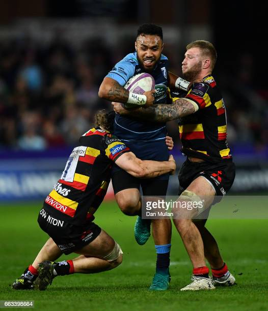 Willis Halaholo of Cardiff Blues is tackled by Jacob Rowan and Ross Moriarty of Gloucester during the European Rugby Challenge Cup quarter final...