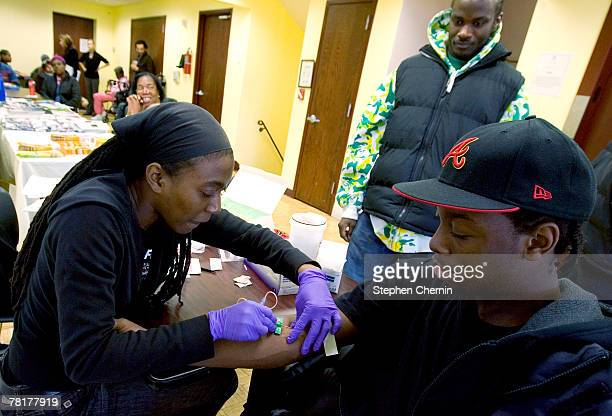 Willis Jones has blood drawn for sexually transmitted infections such as yphilyis and gonorrhea at the Iris House November 30 2007 in New York...