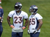 Willis McGahee and Lance Ball running backs for the Denver Broncos watch drills during mini camp June 12 2013 at Dove Valley