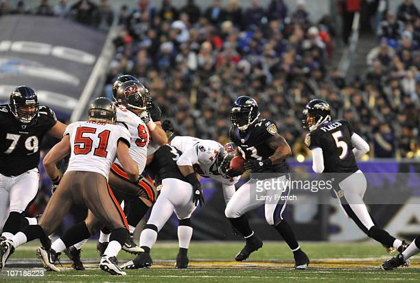Willis McGahee of the Baltimore Ravens runs the ball against the Tampa Bay Buccaneers at MT Bank Stadium on November 28 2010 in Baltimore Maryland...