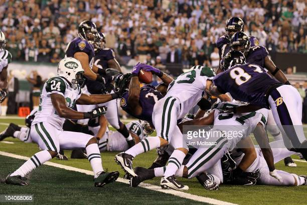 Willis McGahee of the Baltimore Ravens scores a touchdown against Darrelle Revis of the New York Jets during their home opener at the New Meadowlands...