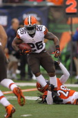 Willis McGahee of the Cleveland Browns runs the ball upfield during the game against the Cincinnati Bengals at Paul Brown Stadium on November 17 2013...