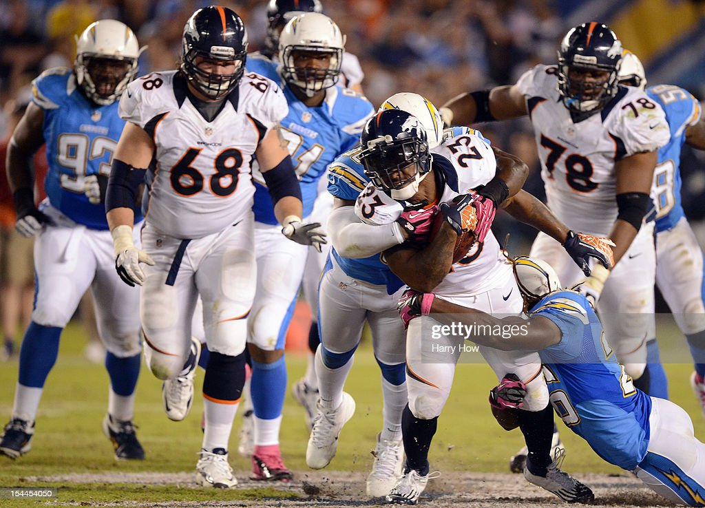 Willis McGahee #23 of the Denver Broncos is tackled by Atari Bigby #26 of the San Diego Chargers at Qualcomm Stadium on October 15, 2012 in San Diego, California.