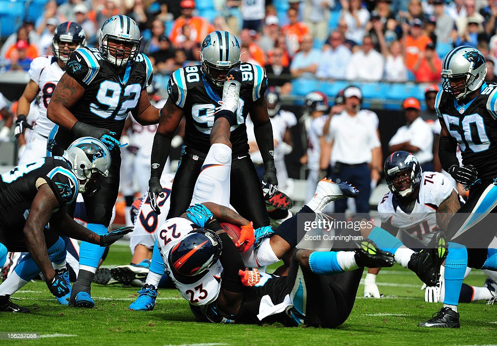 Willis McGahee #23 of the Denver Broncos is tackled by Charles Johnson #95 of the Carolina Panthers at Bank of America Stadium on November 11, 2012 in Charlotte, North Carolina.
