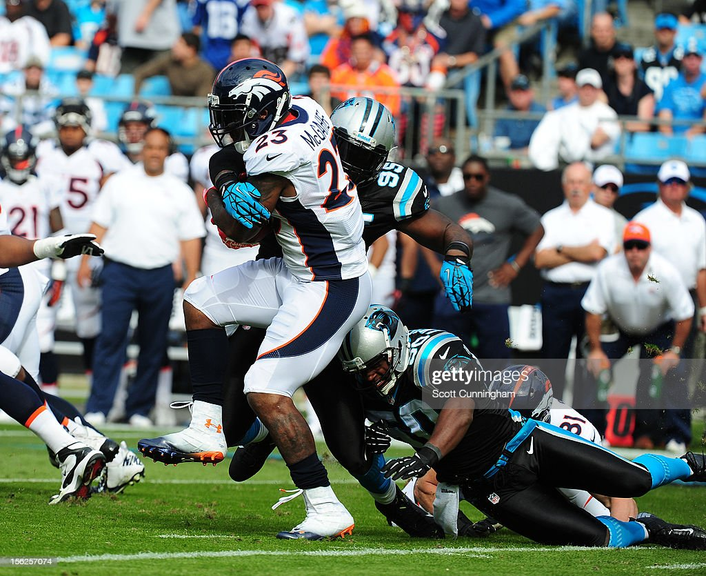 Willis McGahee #23 of the Denver Broncos is tackled by James Anderson #50 and Charles Johnson #95 of the Carolina Panthers at Bank of America Stadium on November 11, 2012 in Charlotte, North Carolina.