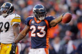Willis McGahee of the Denver Broncos points with the ball after a run against the Pittsburgh Steelers during the AFC Wild Card Playoff game at Sports...
