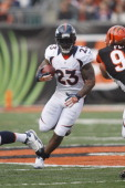 Willis McGahee of the Denver Broncos runs the ball upfield during the game against the Cincinnati Bengals at Paul Brown Stadium on November 4 2012 in...